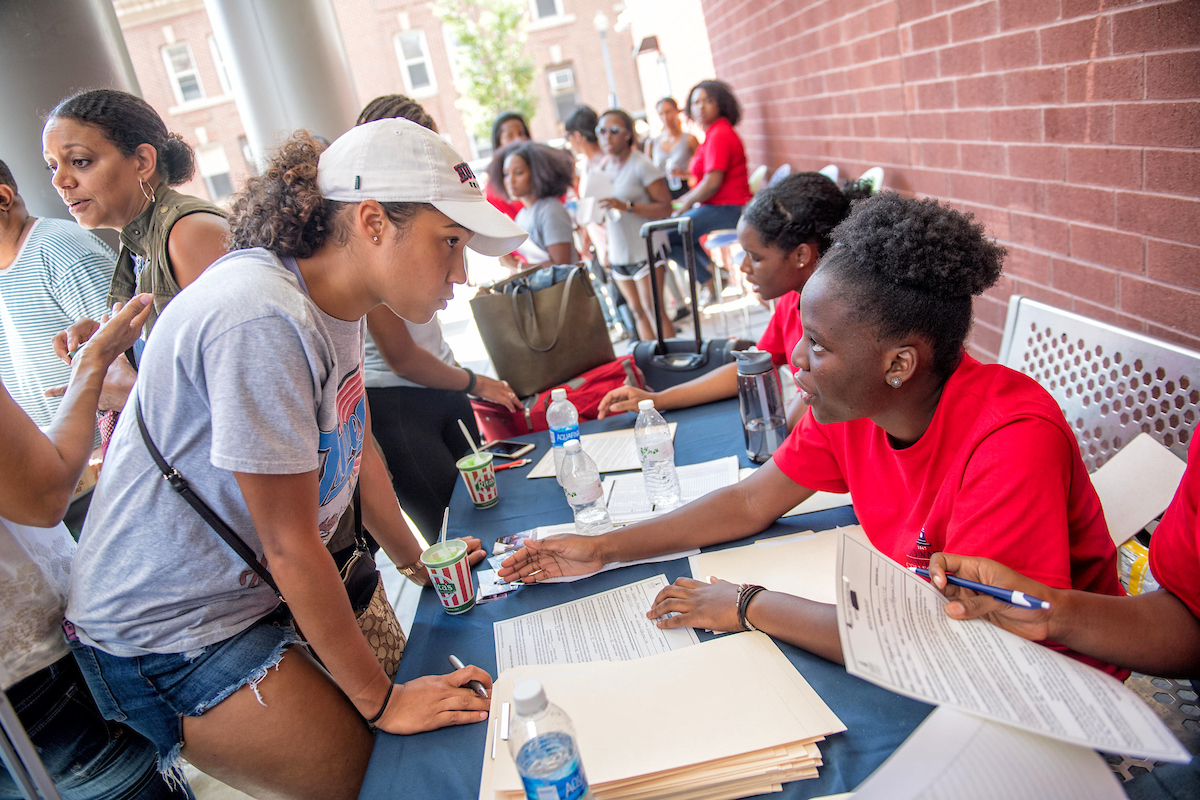 Students talking during move in day