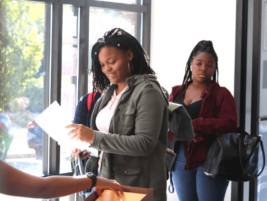 Students gather in Bunche Center to submit passport applications and take photos